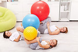 Kids and their mother exercising at home
