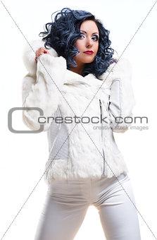 Beautiful brunette in white fur coat