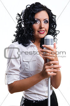 Beautiful young woman with headphones and microphone