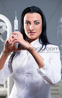 Attractive woman with medical syringe