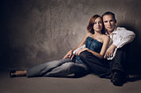Beautiful young couple in love indoor, studio shot