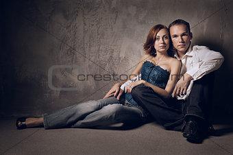 Beautiful young couple in love indoor, studio shot