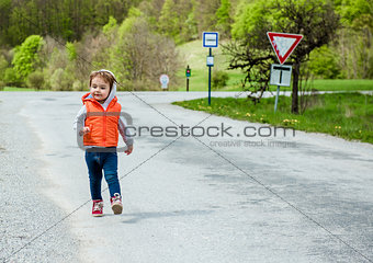 Baby walking on the road