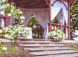 Beautiful wedding gazebo with flower decoration