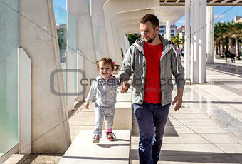 Dad and daughter walking outdoors