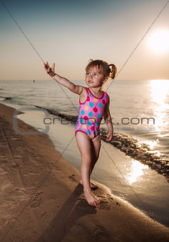 Adorable baby girl on the seaside