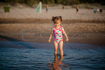 Adorable baby girl in the sea