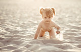 Adorable baby girl on the beach