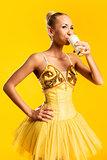 Ballerina drinking kefir