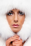 Portrait of a beautiful woman in white fur cap