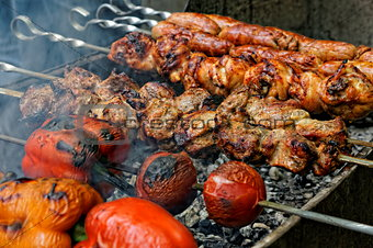 Grilled sausages, meat and vegetables on barbecue