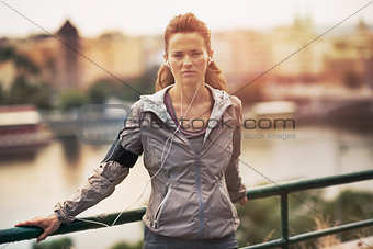 Portrait of fitness young woman in the city in the evening