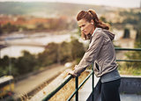 Fitness young woman looking into distance outdoors