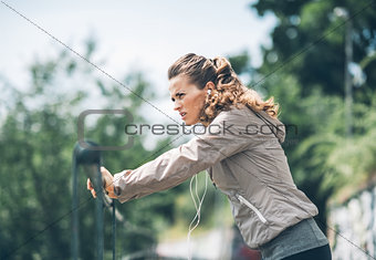 Fitness young woman workout in the city park