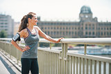 Portrait of fitness young woman in the city looking into distanc