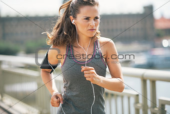 Fitness young woman jogging in the city
