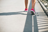 Closeup on fitness young woman walking in the city