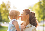 Portrait of happy mother and baby girl outdoors