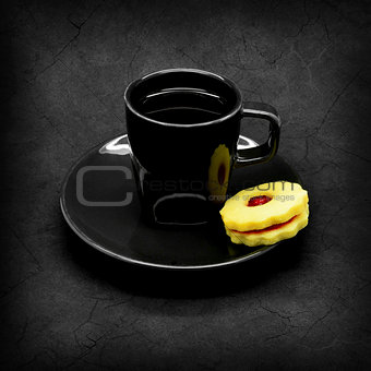 Black cup of coffee on a gray cracked background