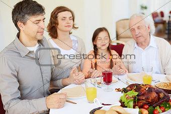 Praying before festive dinner
