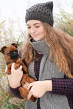 Sweet winter teenager and her little dog