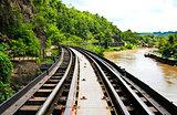 Dead railway beside cliff, along Kwai river in Thailand
