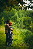 Young couple standing near water