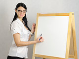 Business woman writes on a white board marker