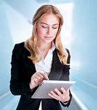Business woman using touch pad