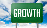 Growth on Green Highway Signpost.