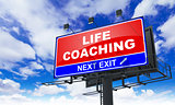 Life Coaching Inscription on Red Billboard.