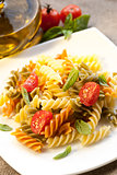 Pasta fusilli with tomato and basil