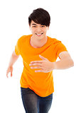 Young happy man make a running pose