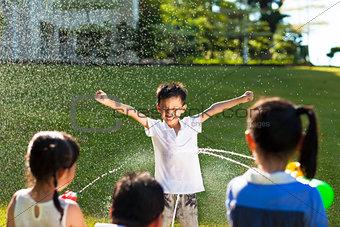 little boy Punishment for water gun spray to wet body