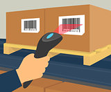 Human hand is scanning a box with barcode