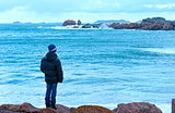 Boy and Tregastel coast view (Brittany, France)