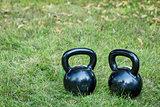 two heavy iron  kettlebells