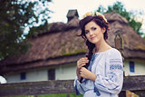 Young beautiful woman in traditional Ukrainian clothing