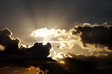 Sunset sky with dark clouds and sun rays