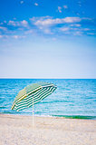Striped Umbrella On Sandy Beach