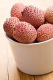 tasty litchi fruit in ceramic bowl