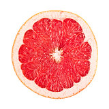 sliced red grapefruit on white