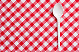 plastic spoon on checkered tablecloth