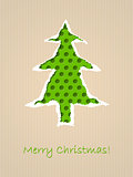 Ripped paper christmas card with dotted green tree