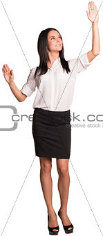 Beautiful businesswomen standing and pushing an imaginary buttons