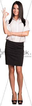 Beautiful businesswomen standing and showing ok hand sign
