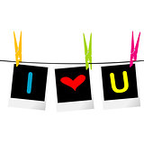I love you concept with photo frames hanging on rope and colored