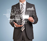 Businessman hold empty card and graphs, world map, network