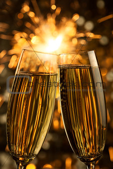 Beautiful golden champagne with sparklers - vertical