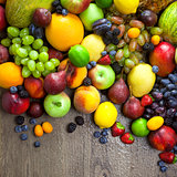 Organic Fruits  with water drops on dark wooden table